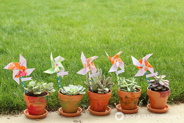 Mother's Day Kids' Craft - Painted Terra Cotta Pots with Pinwheel name labels #mothersday #kidscraft   spotofteadesigns.com