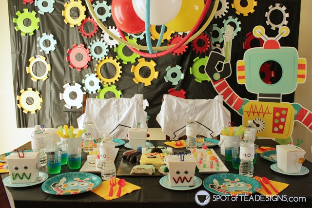 Turn a 13 x 9 sheet cake into a homemade robot cake following this tutorial. Stage at your STEM themed party! | spotofteadesigns.com
