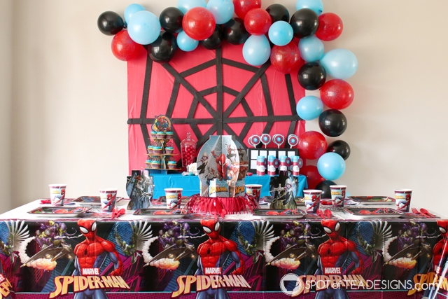 5+ budget friendly spider-man party hacks - crepe streamers to create spider web backdrop   spotofteadesigns.com