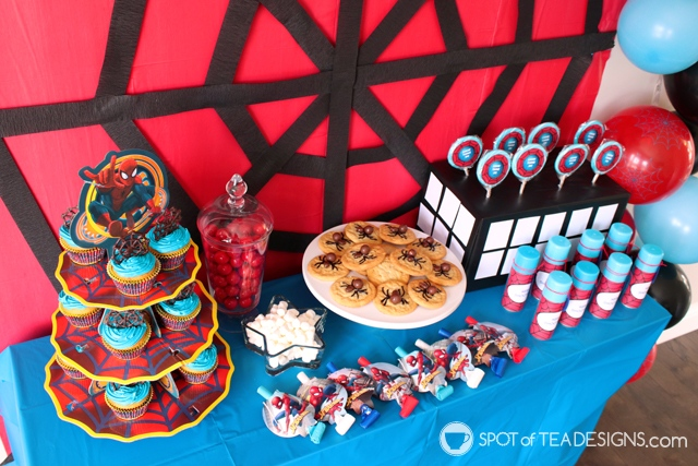 5+ budget friendly spider-man party hacks - lollipop stand is box wrapped in black tablecloth and white cardstock pieces   spotofteadesigns.com
