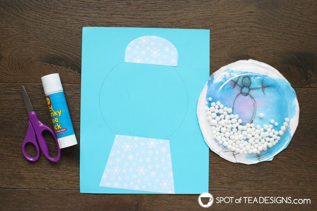 Snow globe kids craft - a fun craft to do with a class! SVG cut file available for some parts | spotofteadesigns.com