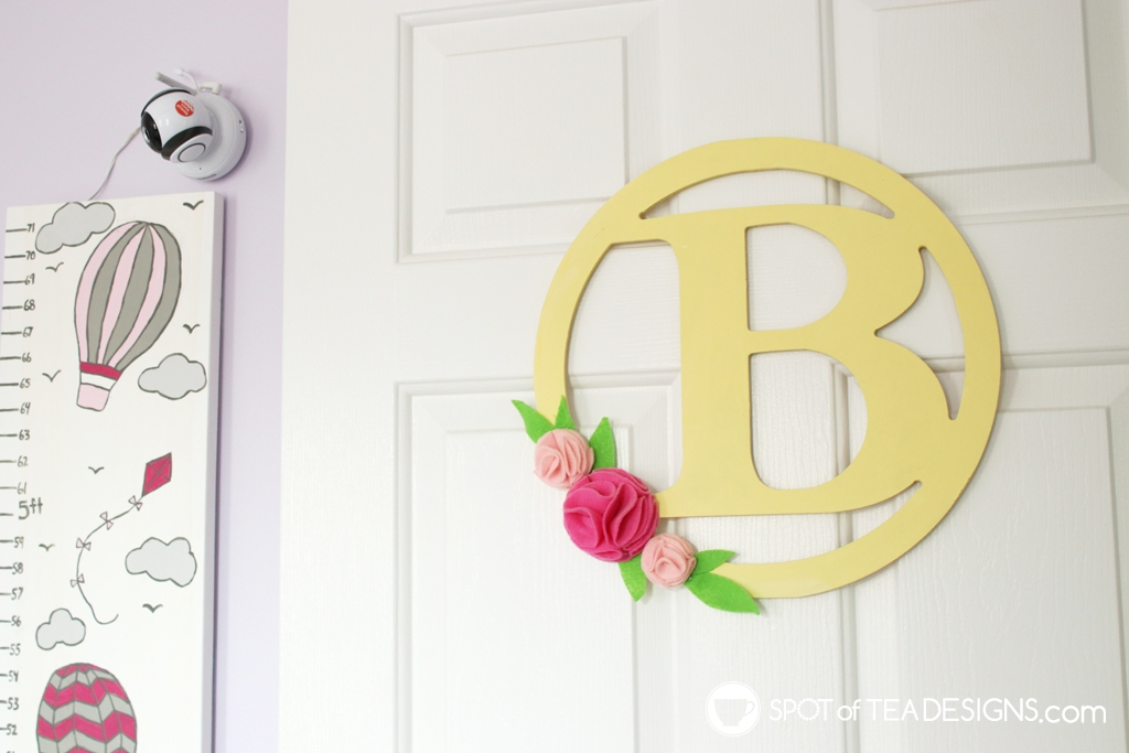 Girl's bright and colorful bedroom tour - door hanger | spotofteadesigns.com