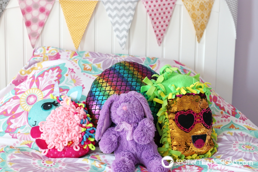 Girl's bright and colorful bedroom tour - plush crafts on the bed | spotofteadesigns.com