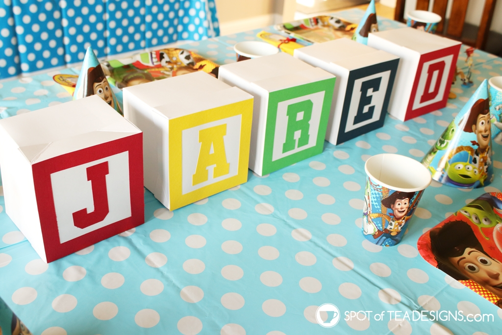 DIY Faux alphabet blocks used in a toy story party - free SVG to create! | spotofteadesigns.com