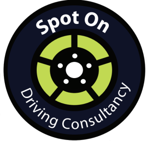 Wheel shaped logo in black with a green insert with Spot On Driving Consultancy around the wall of the tyre