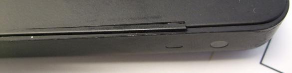Topcase-Riss im schwarzen MacBook