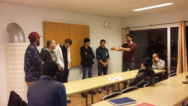 Norwegian course at a company in Norway. Teacher is asking students questions and learning norwegian