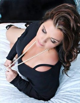 If you need an excuse for a spray tan, a boudoir shoot is a great one.
