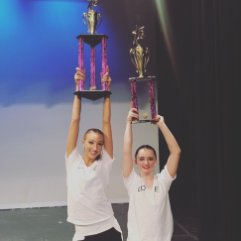 Ava Cota, on the left, after a dance competition.