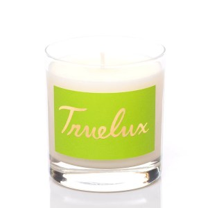 Truelux lotion candle in coconut fragrance. Lime green label