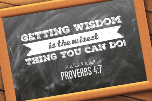 Proverbs 4:7 written on a chalk board inside a tan frame