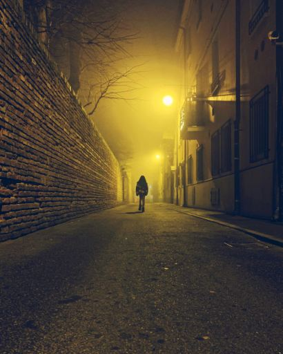 Photo of man walking down a lighted pathway representing one following the guidance of Jesus.