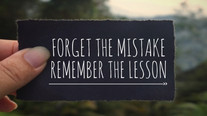 This photo says Forget the mistake, remember the lesson' written on a black paper. Vintage styled background representing letting it go and receiving God's best.