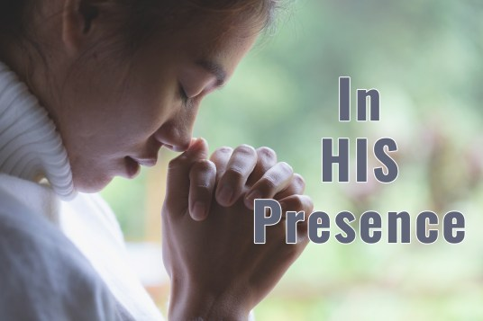Woman praying representing being In HIS Presence.