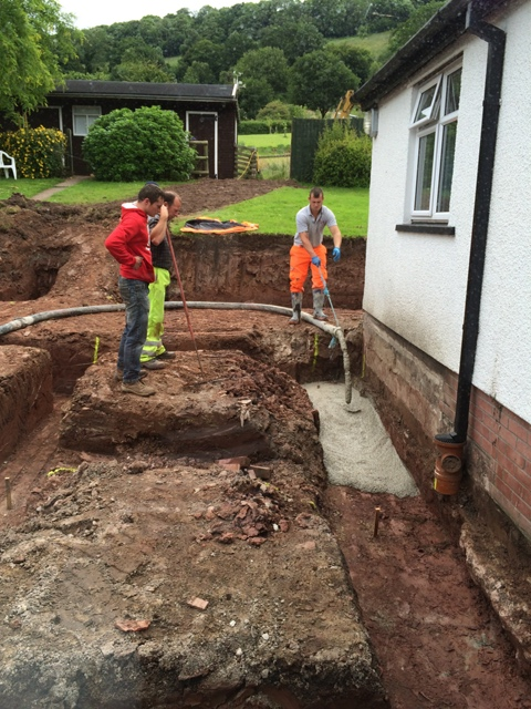 trenches being filled with concrete