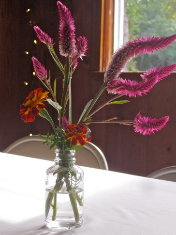The tables were decorated with simple bouquets of celosia and marigolds.