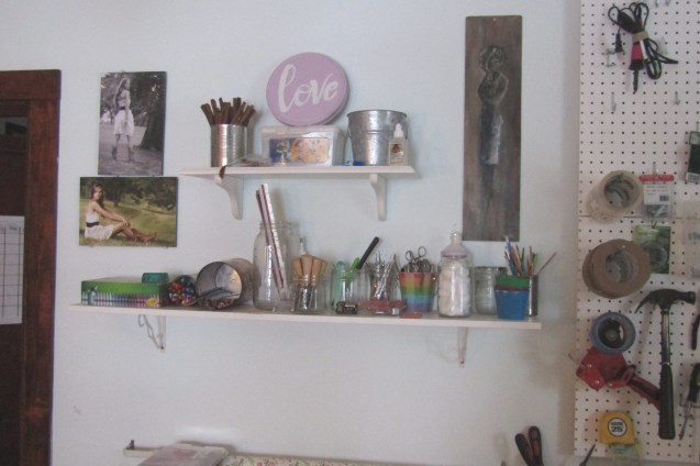Shelves for art supplies and small tools on some second hand shelves.