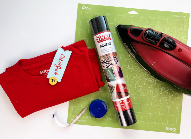 Supplies used to create a custom shirt using heat transfer vinyl