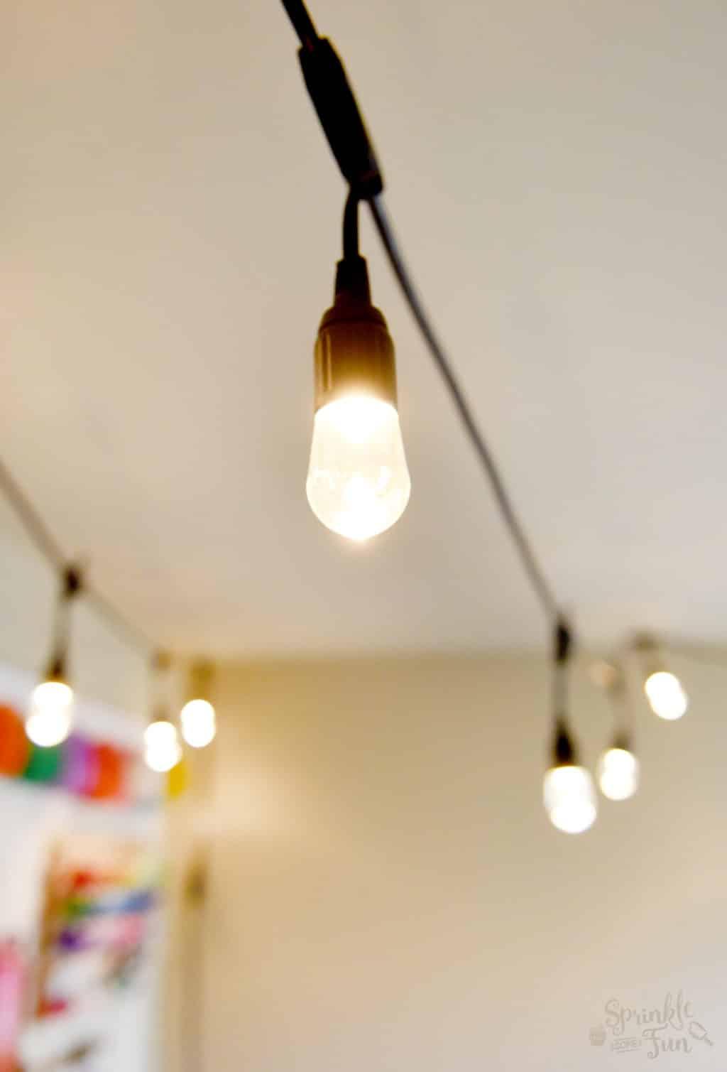 craft room makeover with cafe lights