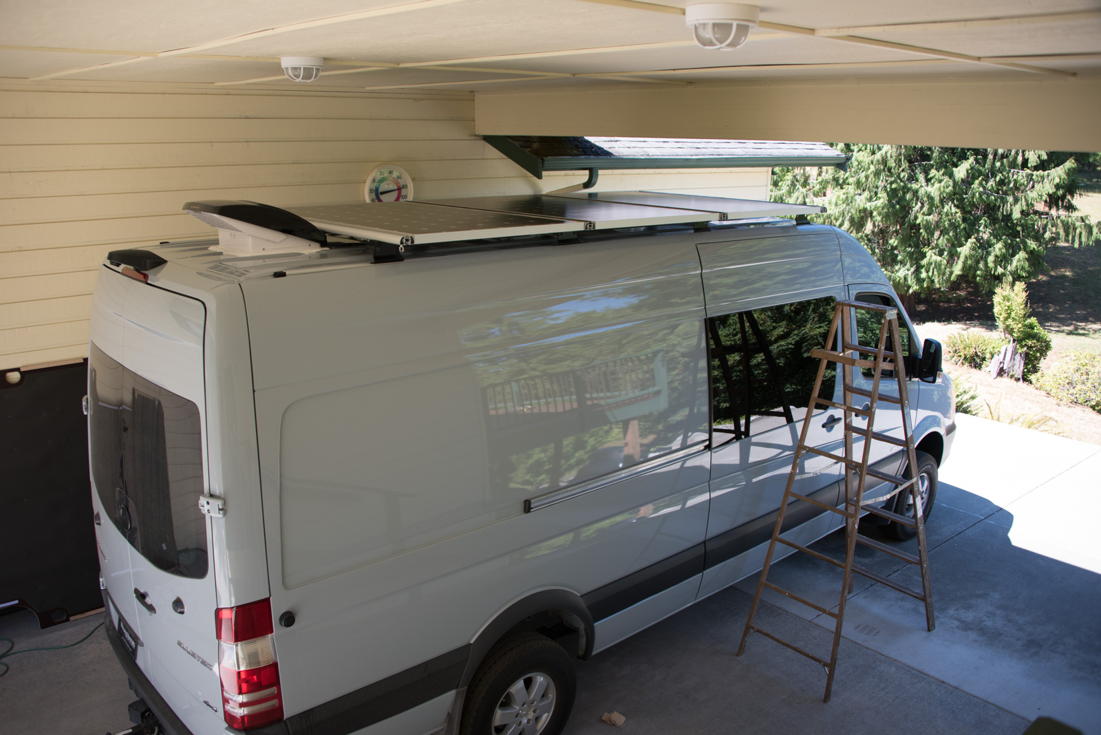 Solar panels mounted to roof rack crosspieces