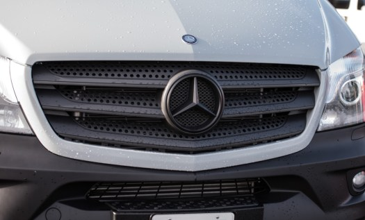Mercedes logo on our van after plastidip. It blends in with the grille really well.