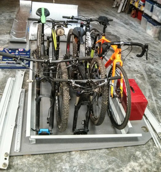 Test-fitting bikes into the slide-out tray we'll use in the van