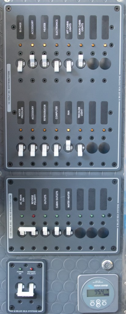 The distribution panels - DC, AC, shore power and Victron BMV700