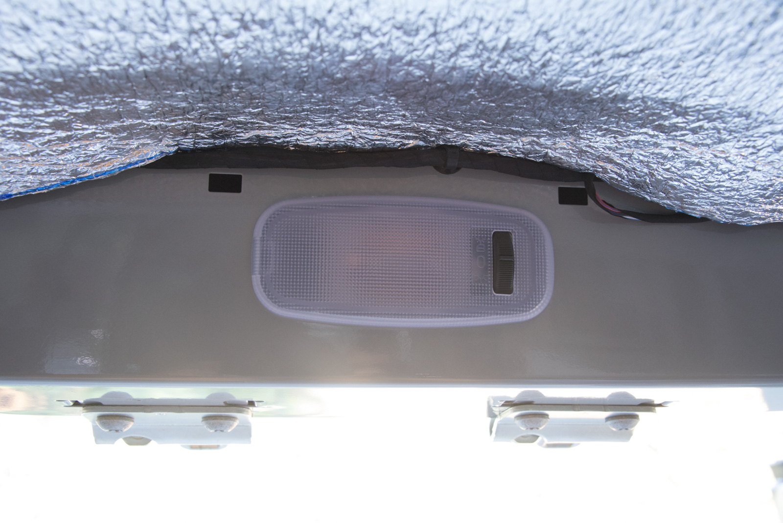 Courtesy light with switch above rear door