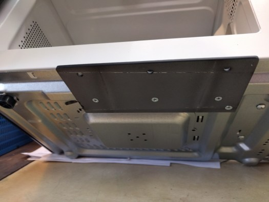 How the microwave attachment plate is attached