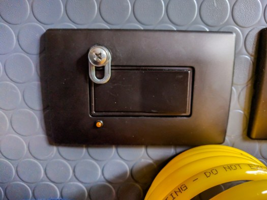 Heater switch with light and safety catch