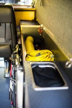 Storage above rear wheel well, l-track to attach cargo tie-downs