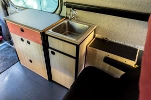 Hot water tank (next to seat), sink cabinet, sliding door cabinet