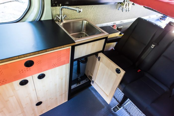 Sink cabinet with grey water tank strapped in underneath