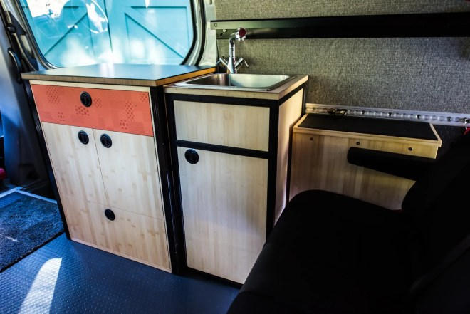 Sliding door cabinet, sink cabinet, hot water tank (next to bench seat)