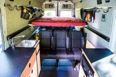 Removable bed platform over rear storage area