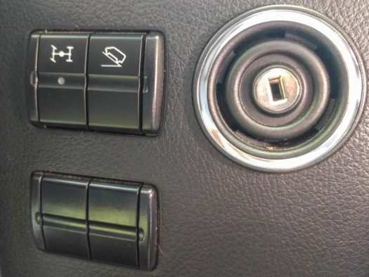 4x4 and low range buttons to the right of the steering wheel