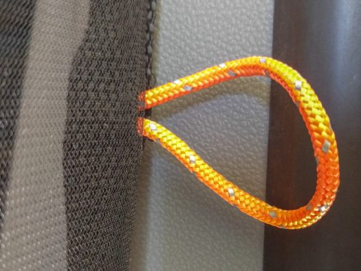 orange paracord loops on the mosquito netting