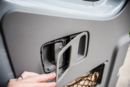 The trim surrounding the door handle is flimsy, so be careful when you remove it.