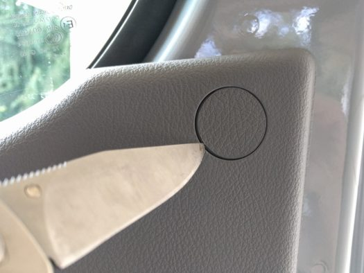 Door panel removal - top screw caps