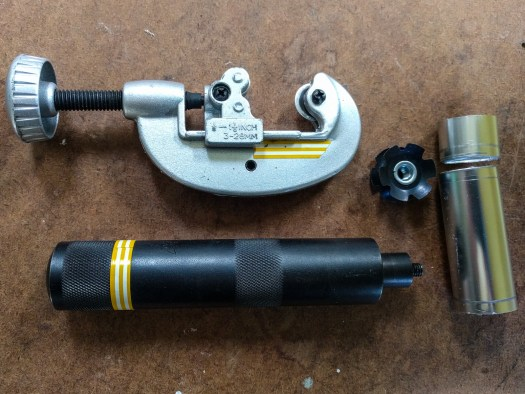 The parts needed to remove and reinstall the star nuts in the top end of the ladder legs