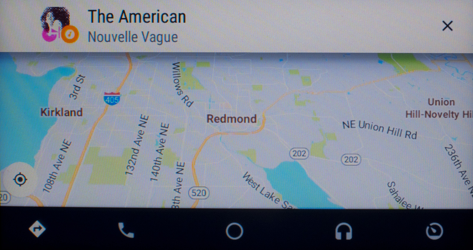 Google Maps (navigation) with a notification card when the music track changes