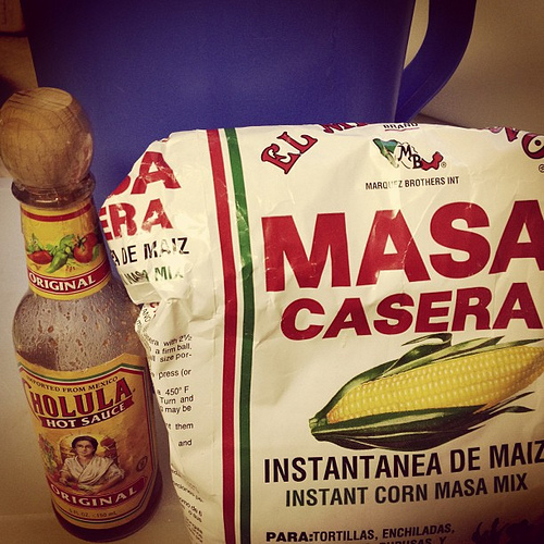 Pitcher of home made chicken broth... Masa... and Cholula...