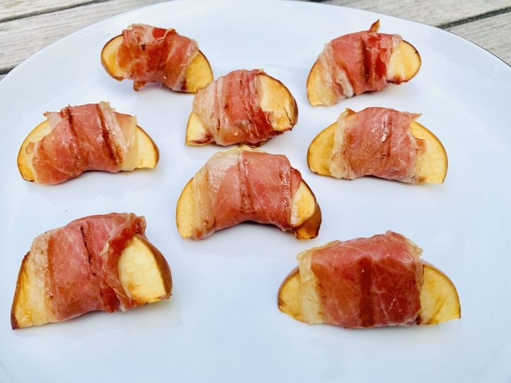 Juicy, ripe white peaches wrapped perfectly with aged prosciutto di parma. Just taken off the Traeger to get that smoky flavor and juiciness in every bite. For more recipes and travel posts be sure to follow me at www.sprouting-vitality.com and on instagram @sproutingvitality. #kenzinthekitch #mckenzieonthemove