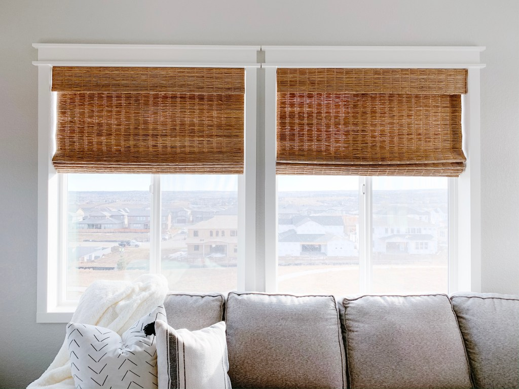 select blinds jute wheat on on windows with casing and pulled halfway down