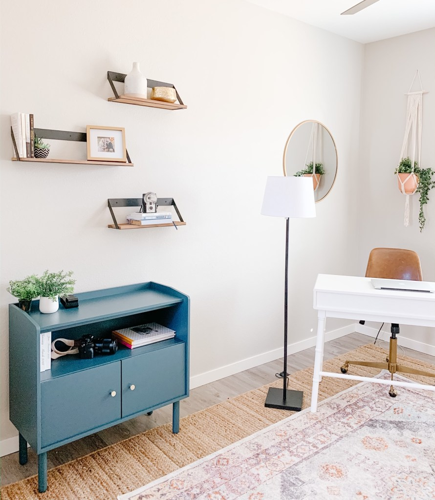 picture of an office with a teal storage cabinet and white desk