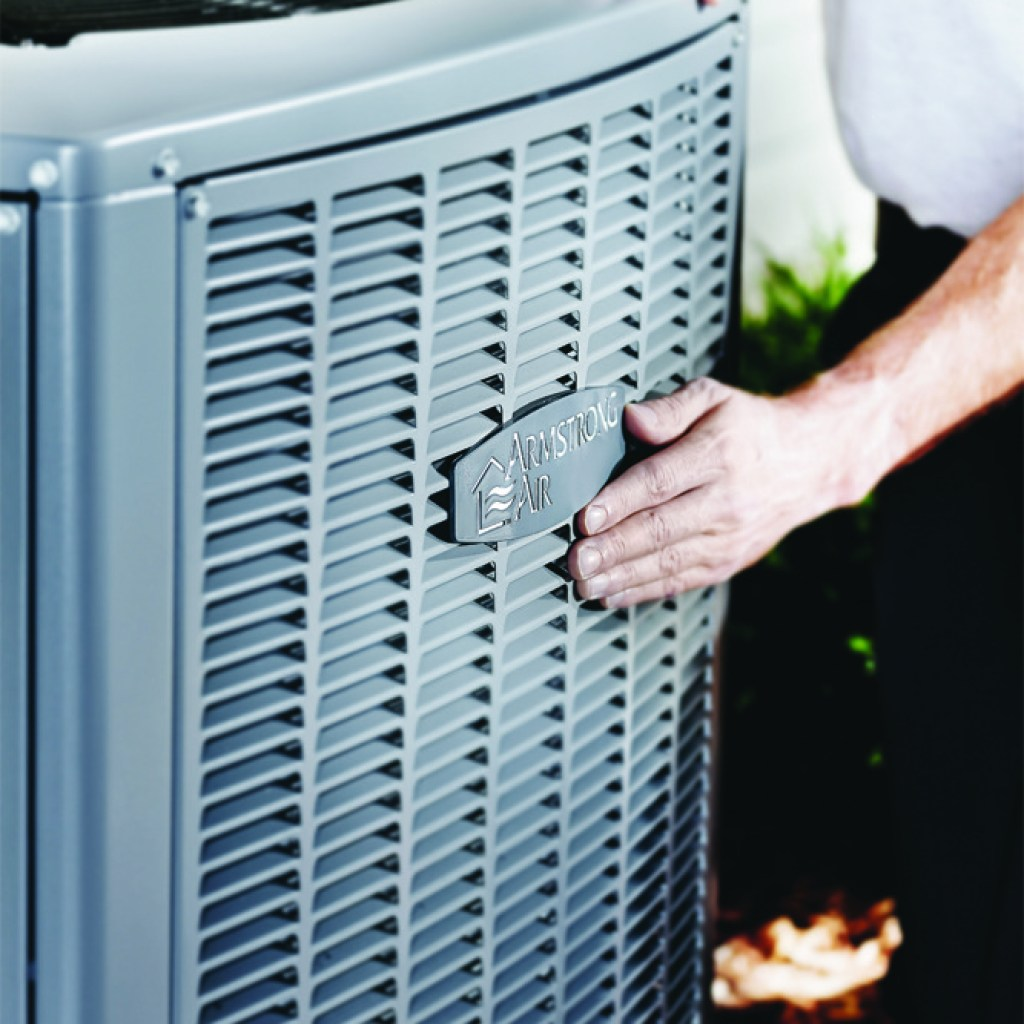 An image of an Armstrong Air AC outside.