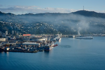 View of Wellington harbour with two tugs working at CentrePort and the Interislander Ferry and Mount Kaukau in the background, taken from Mt Victoria early in the morning on a clear day following a southerly storm. Monday 28 July 2014. Photo: Mark Tantrum / www.marktantrum.com