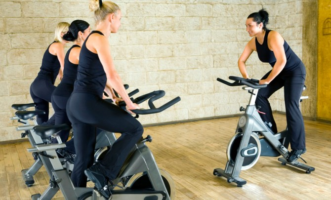 cycle-burn-fat-spin-stationary-bike-work-out-recumbent-upright-gym-stacey-davis-health-spry