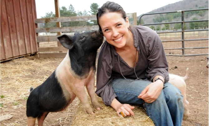 Jenny Brown with pig on her farm.