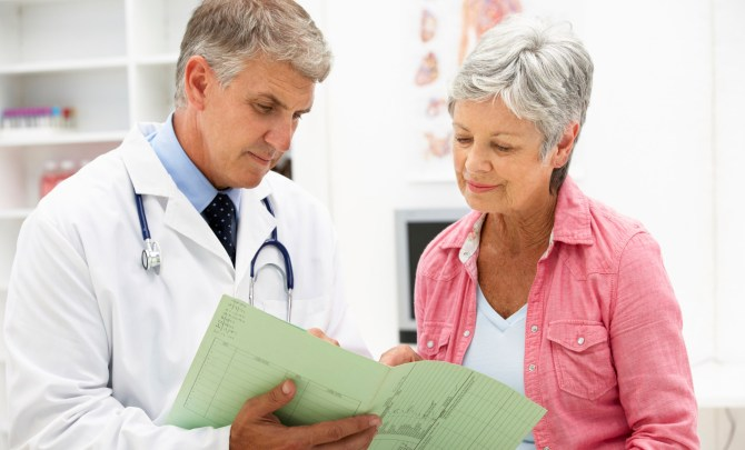 Woman getting a check up on strange symptoms at the doctor.